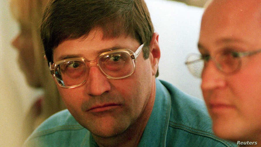 FILE - Leader of an Apartheid-era police and torture squad< Eugene de Kock, is seen at a hearing of the Truth and Reconcilliation Commision (TRC) in Pretoria Sept. 14, 1998.