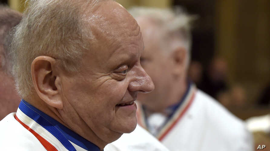 FILE - In this Jan.26, 2018 photo, French chef Joel Robuchon attends the funeral ceremony for late French chef Paul Bocuse at the Saint-Jean cathedral, in Lyon, central France. (Philippe Desmazes/Pool Photo via AP)