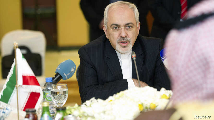 FILE - Iran's Foreign Minister Mohammad Javad Zarif attends a working luncheon in Kuwait.