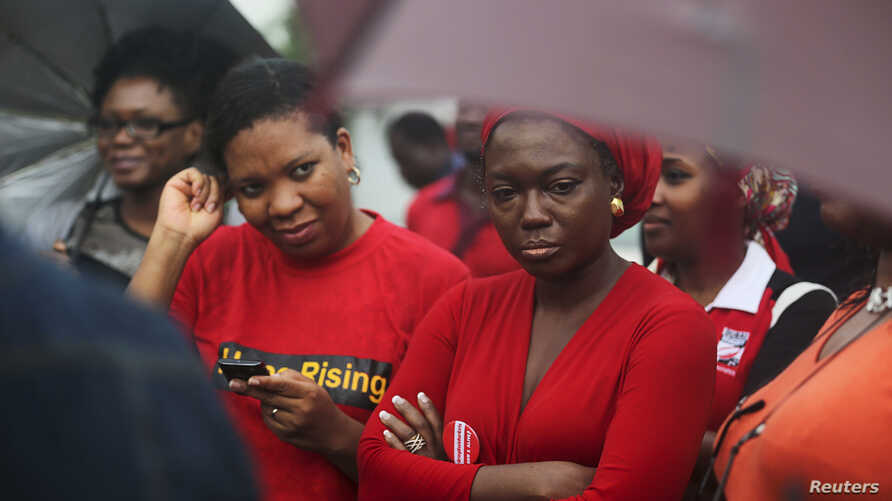 Activists pressure Nigeria's government to find schoolgirls abducted in April. The Bring Back Our Girls initiative sponsored a rally in Lagos July 5, 2014.