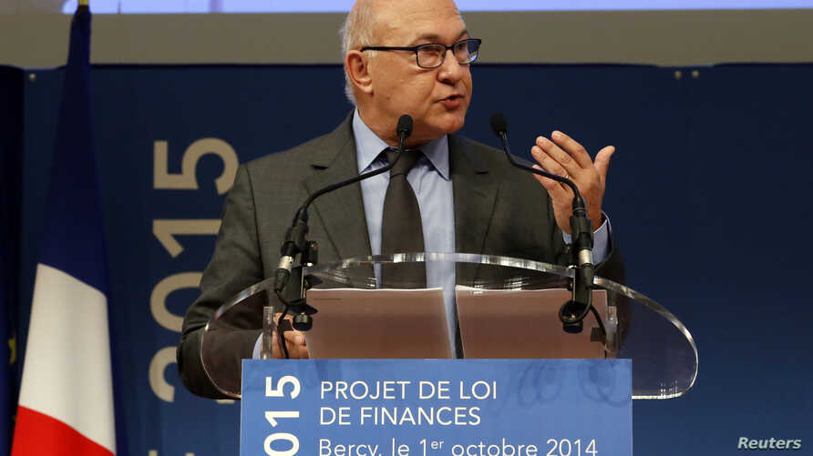 French Finance Minister Michel Sapin attends a news conference to announce the 2015 Budget Project at the Bercy Ministry in Paris, October 1, 2014.