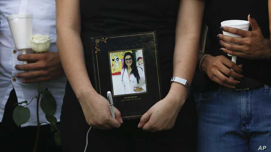 Friends and colleagues gather during a vigil in honor of Brazilian medical student Rayneia Lima, who was shot and killed in Managua, Nicaragua, July 26, 2018.