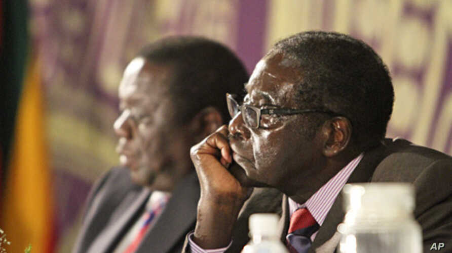 Zimbabwean President Robert Mugabe, right,  with Prime Minister Morgan Tsvangirai, Harare,  Nov. 11, 2011.