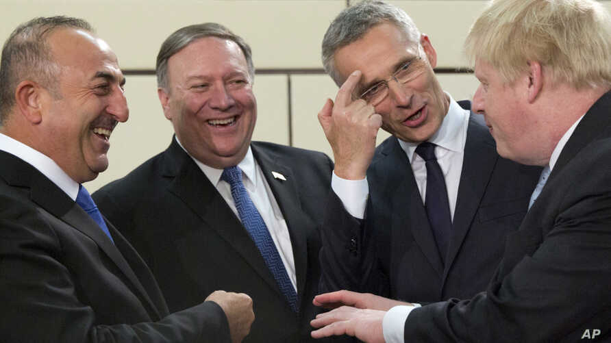 From left, Turkish Foreign Minister Mevlut Cavusoglu, U.S. Secretary of State Mike Pompeo, NATO Secretary-General Jens Stoltenberg and British Foreign Secretary Boris Johnson speak prior to a meeting of NATO foreign ministers at NATO headquarters in