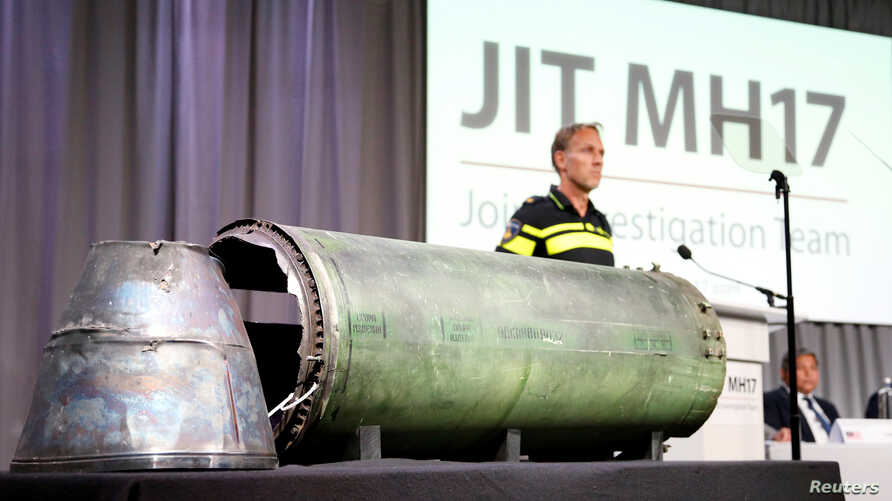 A damaged missile is displayed during a news conference by members of the Joint Investigation Team, who presented interim results in the ongoing investigation of the 2014 MH17 crash in Bunnik, Netherlands, May 24, 2018.
