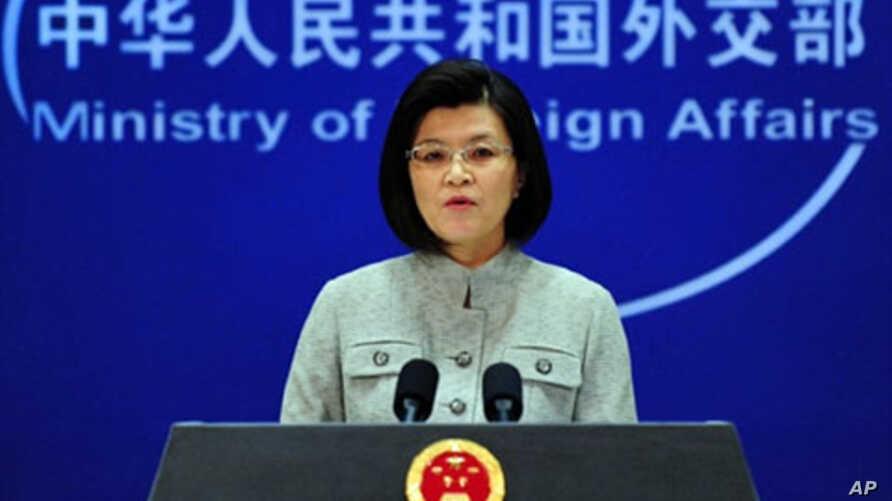 Chinese foreign ministry spokeswoman Jiang Yu responds to questions during a press briefing in Beijing where China reiterated its opposition to the use of force in Libya amid Western air strikes there and called for an immediate ceasefire in the coun