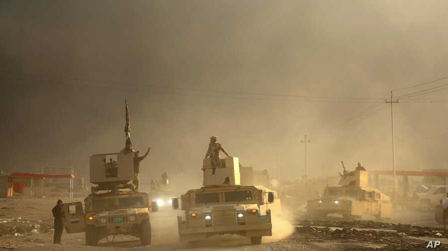 An Iraqi military convoy advances toward the city of Mosul, Iraq, Oct. 19, 2016.