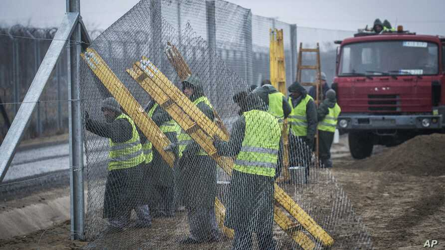 Prison inmates build a second protective fence on the border between Hungary and Serbia, near Kelebia, 178 kilometers southeast of Budapest, Hungary, March 1, 2017.