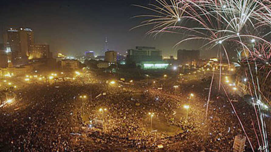 Fireworks explode as tens of thousands of Egyptians celebrate the fall of the regime of former President Hosni Mubarak, and to maintain pressure on the current military rulers, in Tahrir Square in downtown Cairo, Egypt, February 18, 2011