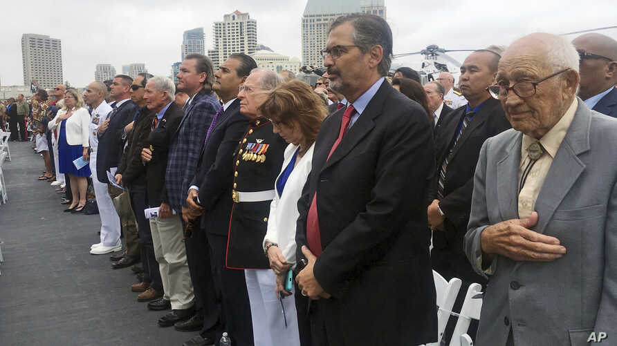 Hundreds of people attend ceremonies marking the 75th anniversary of the Battle of Midway, aboard a retired U.S. Navy aircraft carrier named for the epic World War II battle, in San Diego, June 5, 2017.