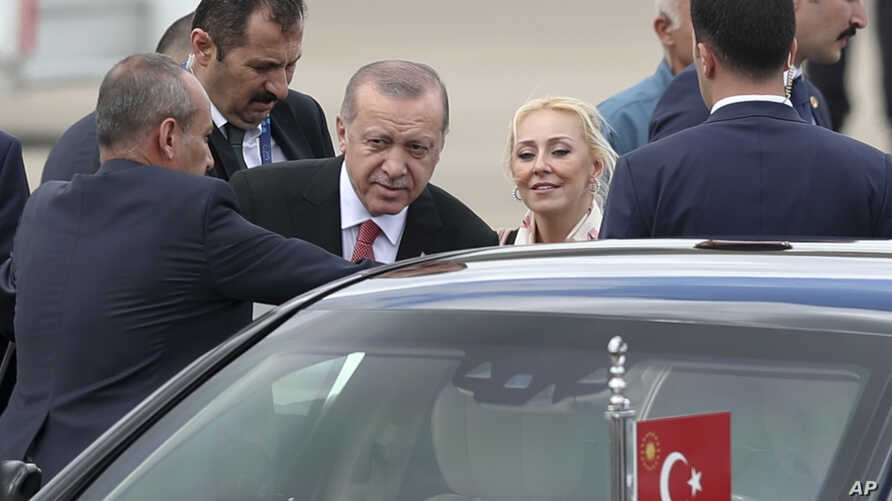 Turkey's President Recep Tayyip Erdogan boards his car after arriving at the Ministro Pistarini international airport to attend the G20 Summit in Buenos Aires, Argentina, Nov. 29, 2018.
