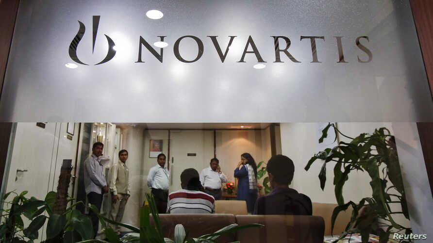 People gather at Novartis India headquarters in Mumbai April 1, 2013.
