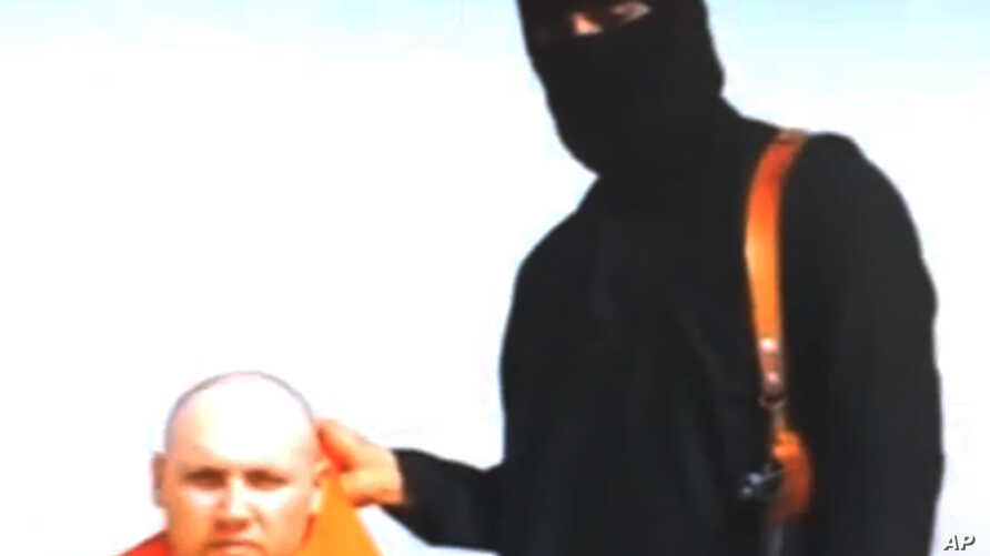 FILE -  File still image from an undated video released by Islamic State militants on Aug. 19, 2014, purports to show journalist Steven Sotloff being held by the militant group.