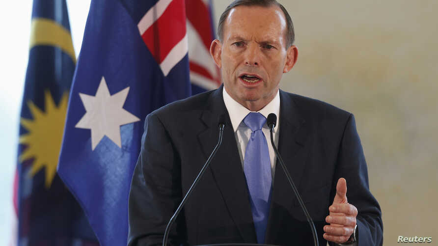 Australian Prime Minister Tony Abbott speaks at a joint news conference with his Malaysian counterpart Najib Razak during an official visit in Putrajaya September 6, 2014. REUTERS/Olivia Harris (MALAYSIA - Tags: POLITICS) - RTR455KR