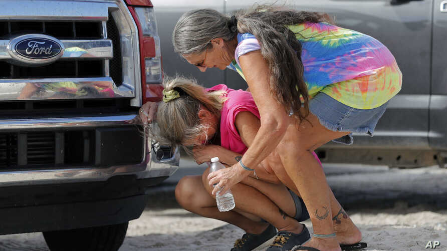 Nancy Register weeps as she is comforted by Roxie Cline, right, after she lost her home and all its contents to Hurricane Michael in Mexico Beach, Fla., Oct. 17, 2018. Register said she doesn't know how she and her husband will make it through this,