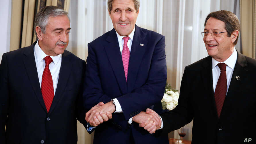 From left: Turkish Cypriot Leader Mustafa Akinci, U.S. Secretary of State John Kerry and Cyprus President Nicos Anastasiades shake hands before a dinner at the UNFICYP Residence, in Nicosia, Dec. 3, 2015.