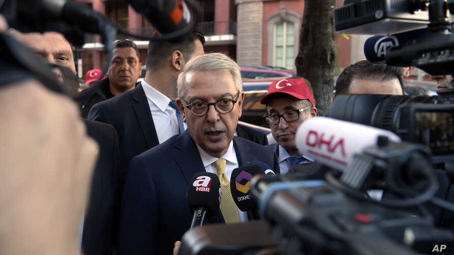 Turkish Ambassador Serdar Kilic, center, speaks to reporters and supporters near the White House in Washington, May 15, 2017.