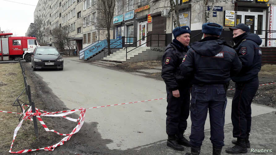 Russian police officers secure a residential area in St. Petersburg, Russia, April 6, 2017.