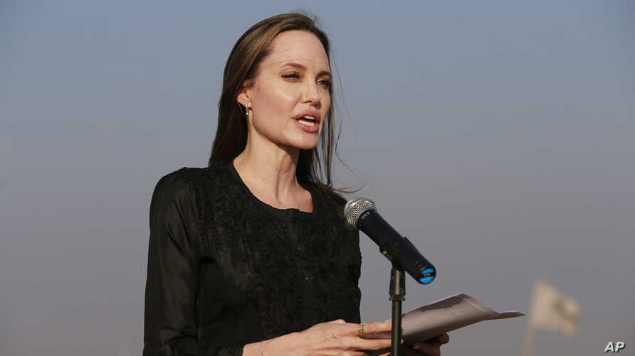 "FILE - Angelina Jolie holds a news conference at Kutupalong refugee camp in Cox's Bazar, Bangladesh, Feb. 5, 2019. Jolie is not ruling out running for public office. The 43-year-old actress and U.N. special envoy tells People magazine ""never say neve"