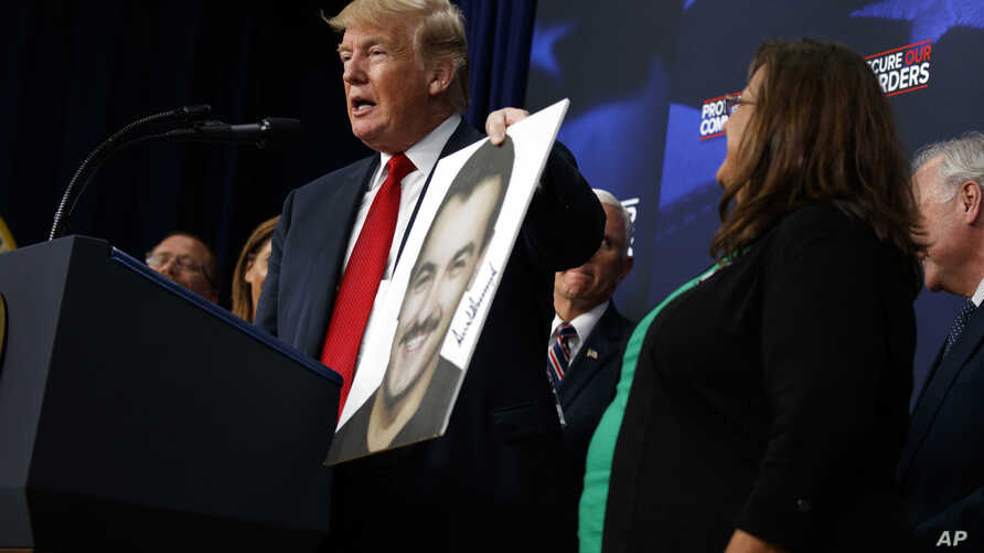 President Donald Trump speaks about immigration alongside family members affected by crimes committed by undocumented immigrants, at the South Court Auditorium on the White House complex, June 22, 2018, in Washington.