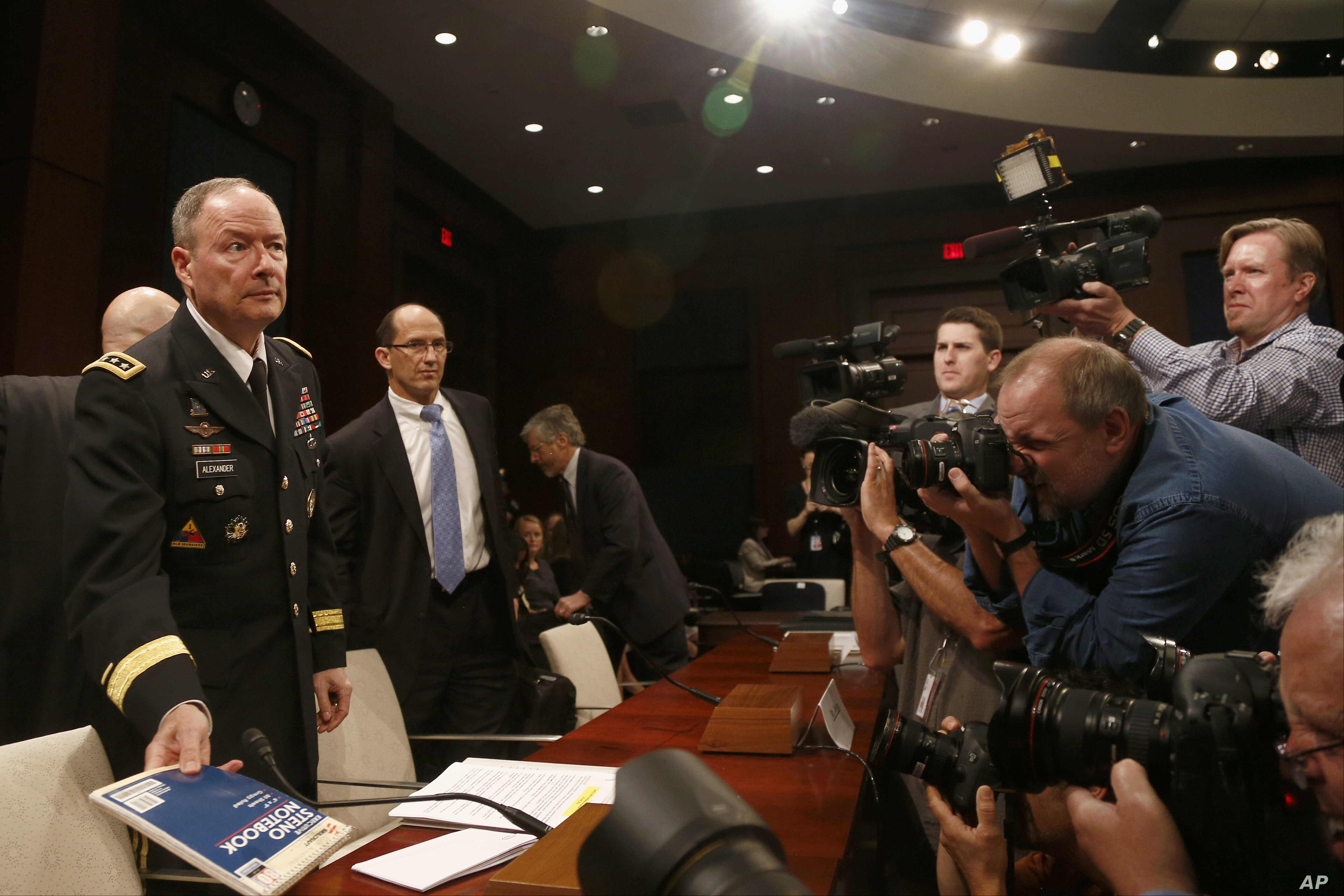 From left: National Security Agency (NSA) Director Gen. Keith B. Alexander; Deputy FBI Director Sean Joyce, and Robert Litt, general counsel to the Office of the Director of National Intelligence (DNI), arrive to testify before the House Intelligence