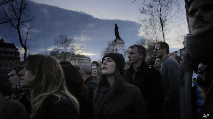 People gather on the Place de la Republique, Sunday, April 10, 2016. Police on April 11 dispersed protesters who had been holding night-time demonstrations since last week over a proposed labor law and social conditions in France.