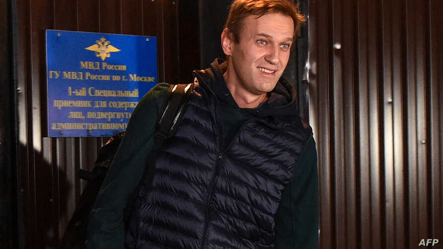 Russian opposition leader Alexei Navalny leaves the detention center in Moscow, early Oct. 14, 2018. He was released after three weeks for organizing anti-Kremlin protests, his second spell in detention in as many months.