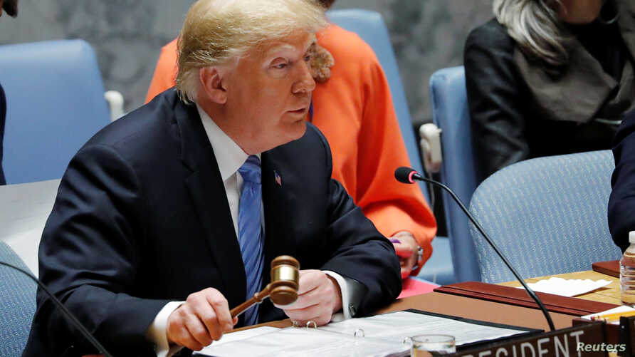 U.S. President Donald Trump, representing the United States as current President of the United Nations Security Council, bangs the gavel to open the U.N. Security Council meeting at the 73rd session of the United Nations General Assembly at U.N. head