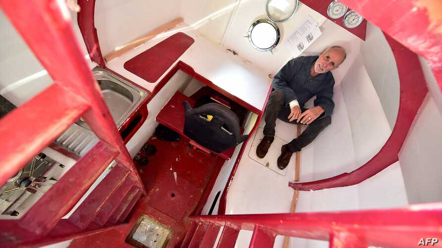 FILE - Jean-Jacques Savin, 71, sits aboard his ship made from a barrel at the shipyard in Ares, southwestern France, Nov. 15, 2018.