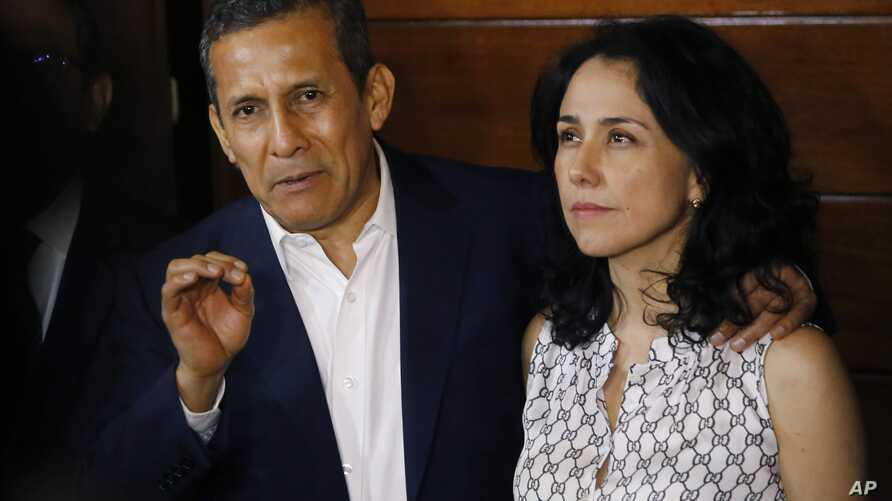 Peru's former President Ollanta Humala speaks next to his wife Nadine Heredia in the door of their home after they were released from prison in Lima, April 30, 2018.