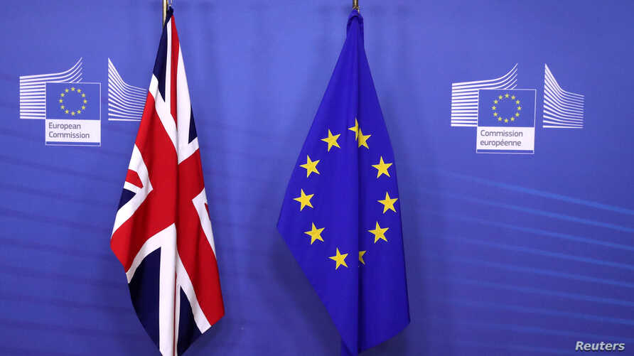 British and EU flags are seen before Britain's Prime Minister Theresa May meets with Commission President Jean-Claude Juncker to discuss draft agreements on Brexit, at the EC headquarters in Brussels, Belgium, Nov. 21, 2018.