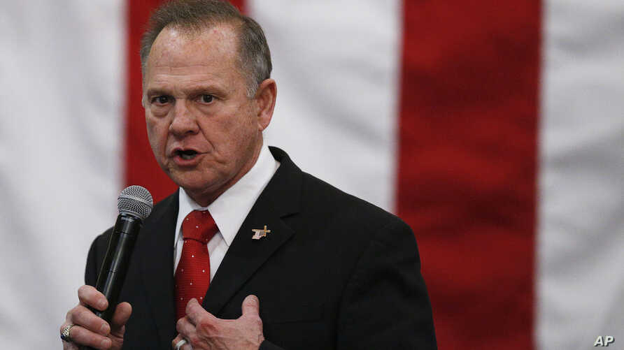 FILE - U.S. Senate candidate Roy Moore speaks at a campaign rally in Midland City, Ala., Dec. 11, 2017. Moore is going to court to try to stop Alabama from certifying Democrat Doug Jones as the winner of the U.S. Senate race.