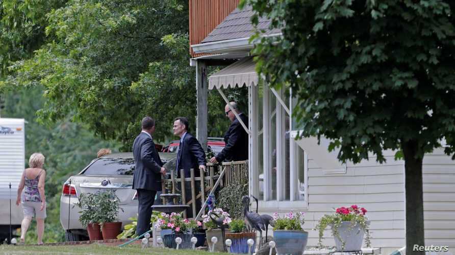 Police search the home of James Hodgkinson, who was identified by law enforcement as the gunman who opened fire on Republican U.S. lawmakers at a Washington-area baseball practice, in Belleville, Illinois, June 14, 2017.
