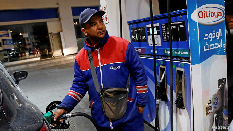 A gas station attendant pumps fuel into a customer's car at a gas station in Tunis, Tunisia, March 31, 2018.