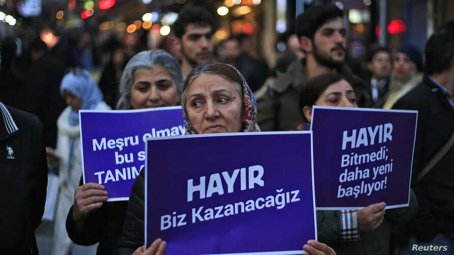 """Supporters of the 'NO' vote, (""""Hayir"""" in Turkish) participate in a protest against the referendum outcome, in Istanbul, Friday, April 21, 2017."""