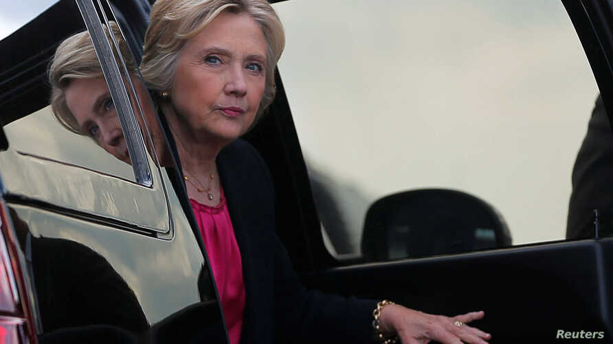 FILE - U.S. Democratic presidential nominee Hillary Clinton arrives at the airport following a campaign Voter Registration Rally at the University of South Florida in Tampa, Florida, United States, September 6, 2016.