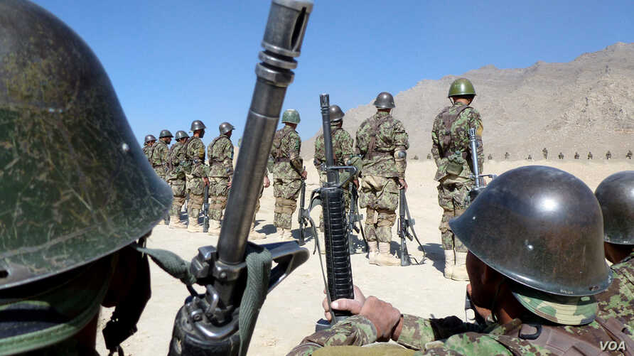 Afghan soldiers train with their weapons at the Kabul Military Training Center on the outskirts of the Afghan capital, November 11, 2012. The Afghan army is preparing for the withdrawal of international combat troops in 2014 when they will assume ful