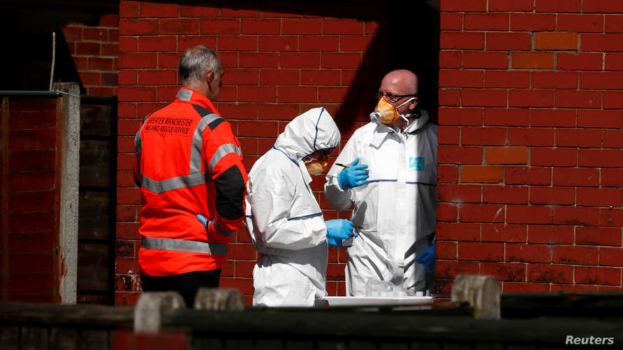 Police investigators work at residential property in south Manchester, Britain, May 23, 2017.