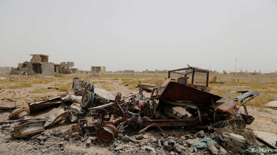 Military vehicle wreckage belonging to Islamic State militants is seen in Falluja, Iraq, June 18, 2016.