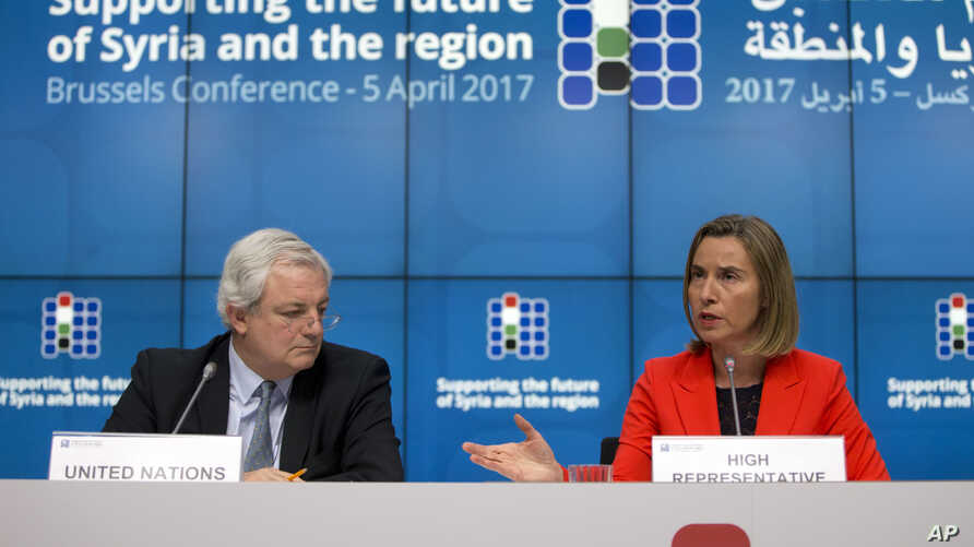 European Union foreign policy chief Federica Mogherini, right, and U.N. Office for the Coordination of Humanitarian Affairs Greg O'Brien, left, address a media conference at an EU Syria conference at the Europa building in Brussels, Belgium, April 5,...