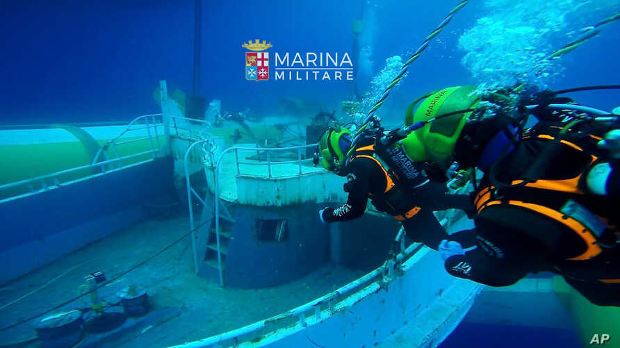 The migrant ship that sank off Sicily last year with an estimated 700 people onboard is being recovered by the Italian Navy, June 28, 2016. The navy says it's raised the boat toward the surface from a depth of more than 1200 feet. (Italian Navy photo