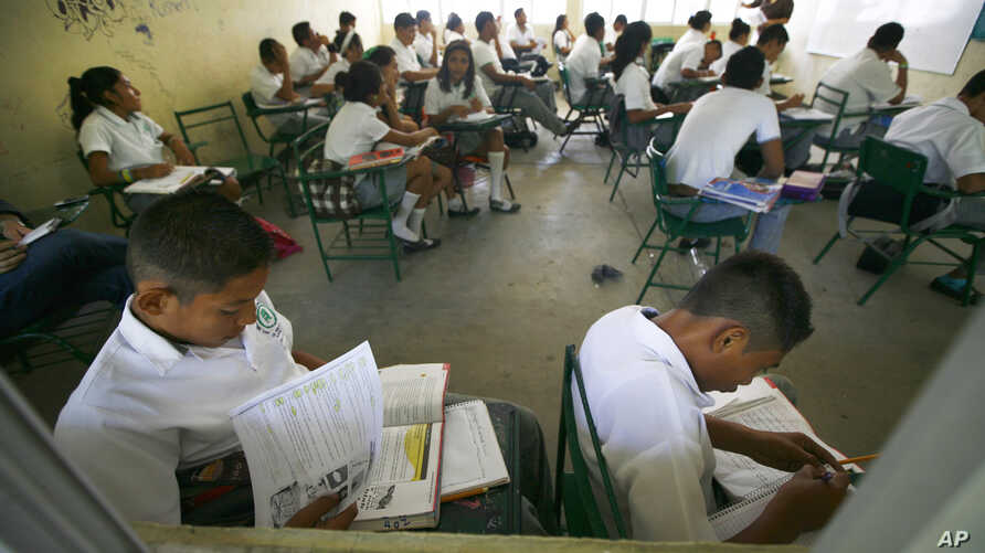 FILE - Students of the Primary School study in their classroom in Acapulco, Mexico, April 9, 2013.