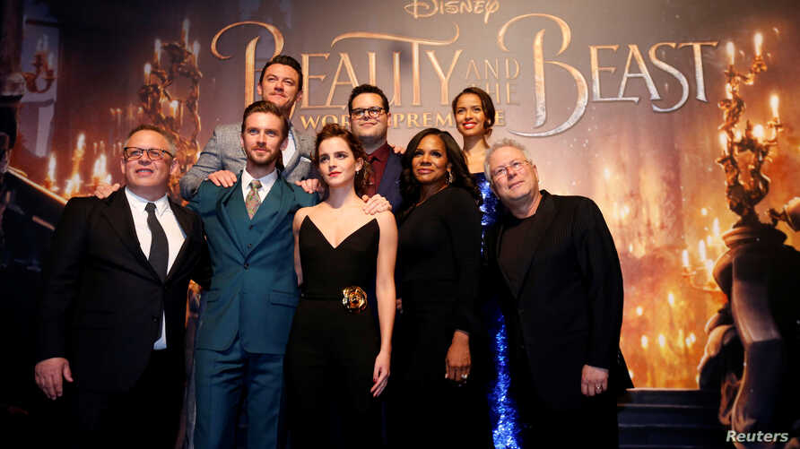 "Director Bill Condon and composer Alan Menken pose with cast members Dan Stevens, Luke Evans, Emma Watson, Josh Gad, Audra McDonald and Gugu Mbatha-Raw at the premiere of ""Beauty and the Beast"" in Los Angeles, March 2, 2017."
