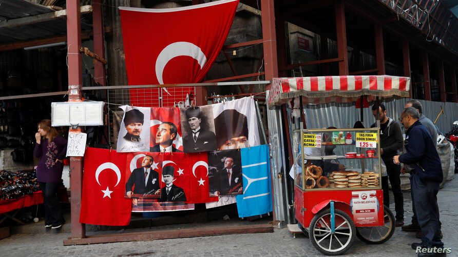 FILE - A street vendor sells baked products in Istanbul, Turkey, Nov. 8, 2017.