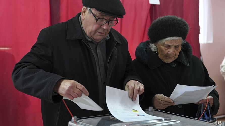 People cast their ballots at a polling station during rebel elections in Donetsk, Ukraine, Nov. 11, 2018.
