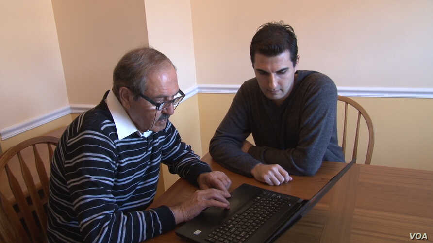 Taofik Alhallak, who fled Syria with his wife in 2012, checks the blog he created to document the crisis in his homeland. They're seeking asylum and, with son Urwa Alhallak, have recently settled in northern Virginia.