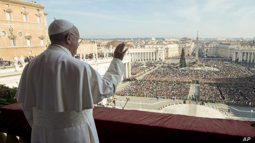 "Pope Francis delivers his ""Urbi et Orbi"" (to the city and to the world) blessing from the central balcony of St. Peter's Basilica at the Vatican, Dec. 25, 2015."