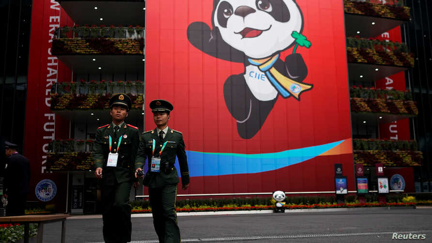 Security guards keep watch at the National Exhibition and Convention Center, the venue for the upcoming China International Import Expo, in Shanghai,  Nov. 3, 2018.
