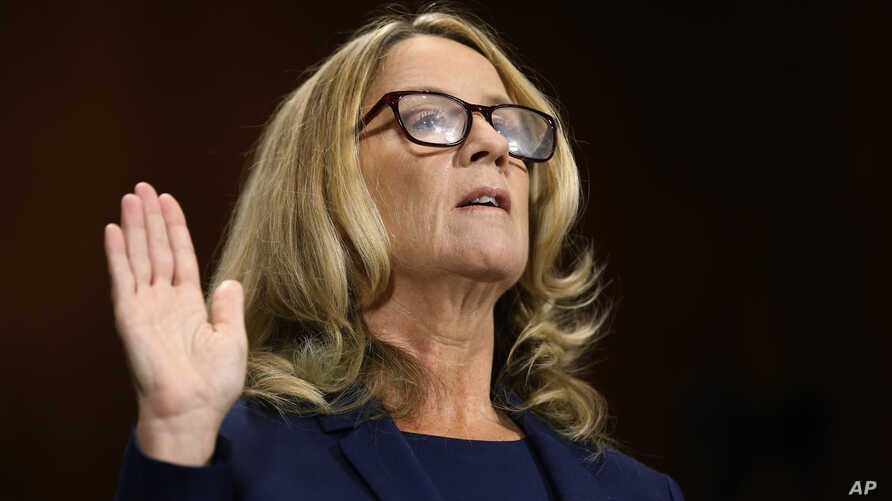 Christine Blasey Ford is sworn in before the Senate Judiciary Committee, Sept. 27, 2018 on Capitol Hill in Washington.