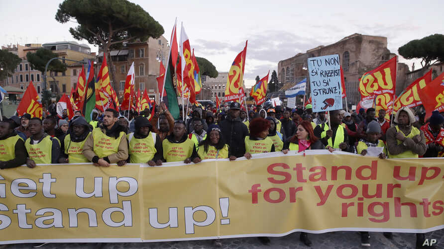 """Demonstrators in Rome shout """"Get Up! Stand Up! Stand Up fo"""